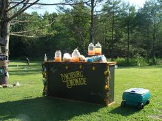 Lemonade bar for a country wedding.  Made from pallets and shipping crates.  Several different flavors of lemonade and a bowl of fruit for garnishes.