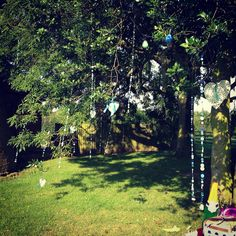 My buttons hanging from the trees, pic doesn't do them justice but they looked so effective! They shimmered in the sun! #DIY #Wedding