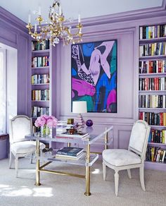 Home library space with lilac walls, a little desk, and a chandelier