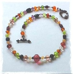 Maggies Beadery womens multi-colored beaded necklace is 17 1/2 inches long. It closes with a pretty antiqued sterling silver toggle clasp.