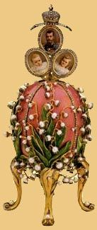 The Lilies of the Valley egg is a masterpeace in Art Nouveau style. The miniature of Tzar Nicholas II and his two daughters Olga and Tatyana painted within the body of the egg. The pictures pop up when a pearl knob is turned.