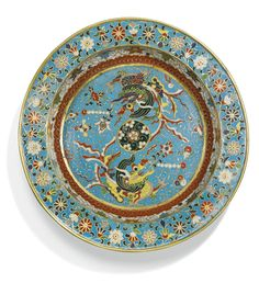 A CLOISONNÉ ENAMEL 'MYTHICAL BEAST' BASIN QING DYNASTY, 17TH/18TH CENTURY the rounded sides rising from a flat base to a wide everted rim, brightly decorated to the interior with two mythical beasts pacing around a central floral medallion on a ground of scrolling clouds scattered with lingzhi, lotus and ball flowers, the cavetto encircled by a stylised ruyi cloud band and scrolling lotus, the rim with an undulating floral scroll on top and stylised ruyi clouds below