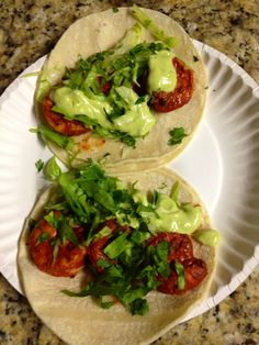 Grilled shrimp tacos with avocado, jalapeño sauce.