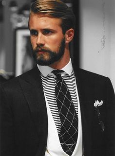 Never wear more than two patterns. This outfit is pulled together by two other strong solids. Great suit! #fashion #mens #suit