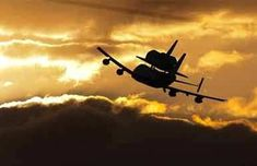 Space Silhouette of Space Shuttle and Transport Jet during Sunset.