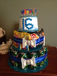 Sweet 16 birthday gift for a boy. Mountain Dew soda, chips and candy, dollar bill bows, and a real cake in top.