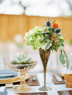 What about a votive in the small footed dessert dish with a wine glass arrangement