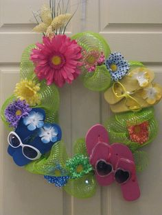 Flip Flop Summer Wreath - LOVE the sunglasses!    Could probably make this with baby flops from mommy sales. or when old navy puts their flops on sale for a buck a pair.