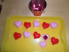 Patterning hearts, hiding Valentine coins in heart boxes, Tray work
