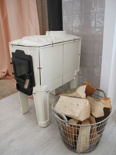 I'm in love with this little white woodstove and the big metal basket next to it.
