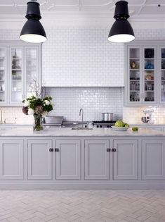 Gorgeous Kitchen using white glass subway tile backsplash.