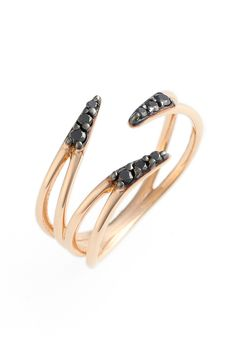 Dashes of flickering bead-set diamonds brighten a polished and modern rose-gold ring designed to be a pinky or as a midi-ring.