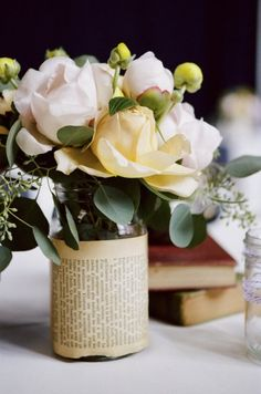 Wrap a page around a jar to make a unique vase. Unique and kind of romantic way to incorporate mutual love for books.