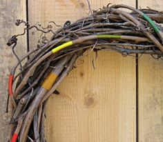 How To: Make a Colorful String-Wrapped Branch Wreath!