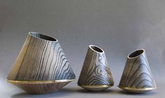 Ellipse vessels, ebonised ash and brass, designed and made by Laurence Brand.