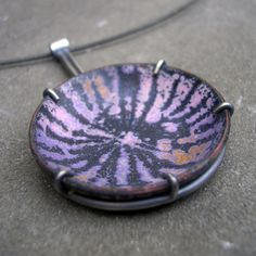 L. Sue Szabo: metal smith and enamelist from the States.Purple Enamel Pendant- Purple, Pink, and Orange Enamel and Sterling Silver.  Sgraffito. Found in her Etsy shop