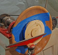 Reversing a bowl on a lathe with masking tape and hot glue.