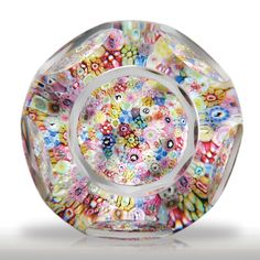 Baccarat 1967 close packed millefiori Church Weight faceted paperweight.