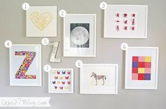 DIY Gallery Art Wall via Cape 27 {LOVE it all!}: 1. yellow string heart on canvas, 2. moon art print, 3. spray painted animal heads, 4. fabric-backed letter, 5. zinc letter, 6. paint chip art, 7. 3D butterfly punch art, 8. zebra art print