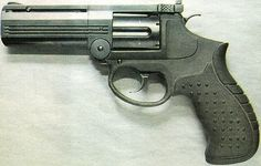 IZHMECH MP-412 REX Revolver. A Russian prototype that never saw production due to US/Russia trade agreements. Featured a break-open frame with simultaneous extraction, a polymer sleeve over the steel lower frame, and a conventional trigger.