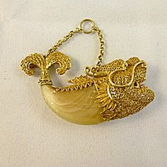 Tigers Claw Pendant, Fish Shaped in High Carat Gold. Click on the image for more information.