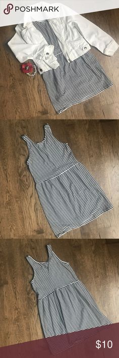 Old Navy Black and White Striped Sleeveless Dress This comfortable and cute sleeveless dress is black and white striped and from Old Navy. It is a girls size Small (6-7) and is 100% cotton. Pair it with a denim jacket as shown and leggings for fall, and then transition into spring and summer! Super versatile and very comfortable!  Machine wash cold, gentle cycle, tumble dry low, cool iron. Old Navy Dresses Casual