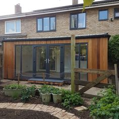 Garden Spaces design and installed this spacious bright and thermally efficient house extension with its sedum living roof. Glass Extension, Extension Ideas, House Extensions, Kitchen Extensions, Conservatory Extension, Living Roofs, Garden Spaces, House Rooms, Cladding