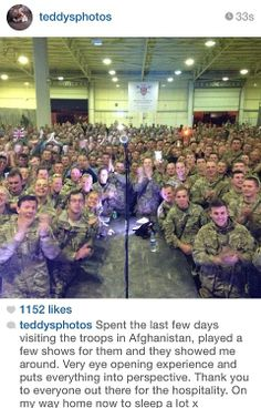 Ed Sheeran playing for British troops.