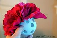 Use dollar store Wiffle Balls to make beautiful flower balls.  Just push the stem through the holes!
