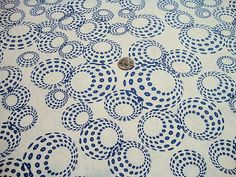 Blue 3-D spheres on a white background is part of Moda's Sphere quilting fabric line.