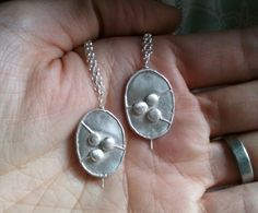 silverpebble: The Shadow Year - honesty seedpod necklace