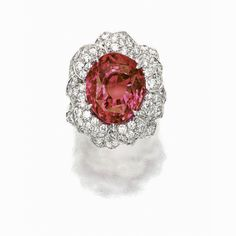 IMPRESSIVE 'PADPARADSCHA' AND DIAMOND RING, CARVIN FRENCH | Lot | Sotheby's