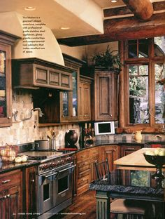 Love the dark color cabinet with black granite counter tops