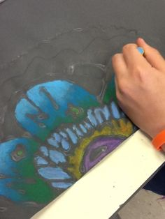 "Art at Becker Middle School: Oil Pastel ""Batiks"": Use glue as the ""resist"" and then color on the black paper."