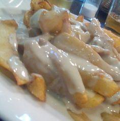 Patatas con salsa de queso Cabrales