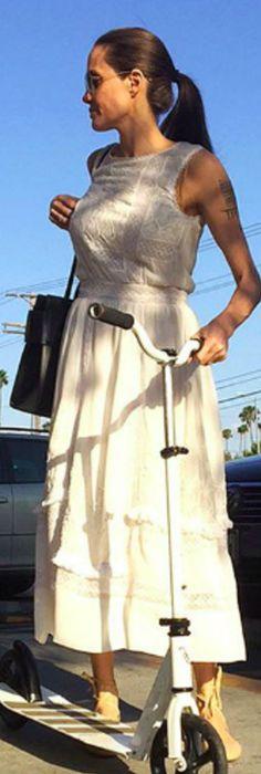 Who made  Angelina Jolie's black handbag and white maxi dress?