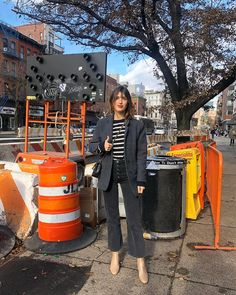 Jeanne Damas, our favorite Parisian went to NYC and wore a gray oversized blazer, black crop flare jeans, a striped sweater, and beige leather boots! We love this Jeanne Damas fall look. French style in New York! Jeanne Damas, French Girl Style, French Girls, French Chic, Parisienne Style, Flare Jeans Outfit, Nyc, Staple Pieces, French Fashion