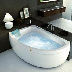 Jacuzzi  Aquasoul Whirlpool Offset Corner Bath -- Nice idea for space saving.