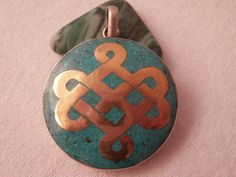 Tibetan buddhist pendant. Never ending cross on by SuloJewellery