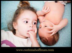 Newborn baby with big sister photo
