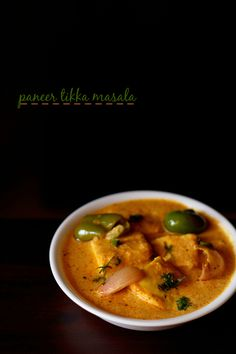 paneer tikka masala restaurant style recipe - marinated grilled paneer cubes in onion-tomato yogurt based curry. step by step recipe.
