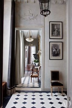 Curtained in a Romo velvet, a light-filled entrance hall greets visitors at a Paris Apartment renovated and decorated by Jean-Louis Deniot.Jean Louis Deniot , Photography by Derry Moore for Architectural Digest