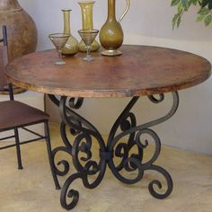 Nice wrought iron dining table base... would look great with a rustic wood top, marble or a more sophisticated glass top.  I love the options it provides.: