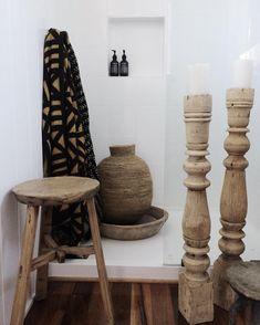 Bathroom Details ✨ #elmstool #furniture #ricetrays #woodenvessels #candlestickholders #mudcloth #textiles #buherabaskets #bathroom…