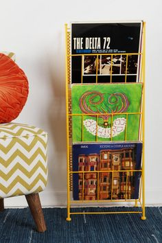 Corner Store Record Rack #UrbanOutfitters - this might be just what we need in the living room! Great for a bathroom. Or guest room