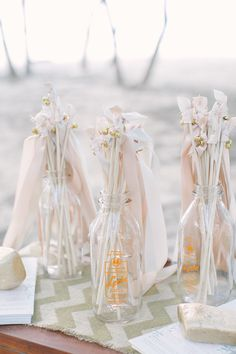Ribbon Wands with little gold bells -- Love it! See more on #smp here: http://www.StyleMePretty.com/destination-weddings/2014/05/14/romantic-costa-rica-wedding-at-reserva-conchal-beach-club/Planning by FournineteenWeddings.com  Photography: Margaux Gamble http://www.margauxphotography.com