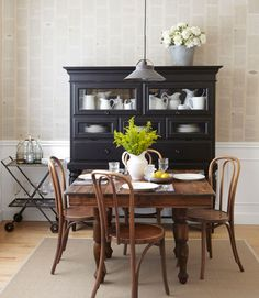Decorating with Antiques Ideas - Country Living May 2013; Heather covered the wall in book pages adhered with diluted craft glue; note columns are staggered