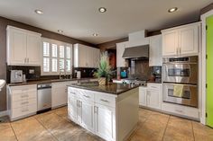 Traditional Kitchen with High ceiling, Kitchen island, L-shaped, Raised panel, Simple granite counters, European Cabinets