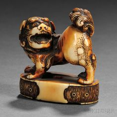 "Ivory Netsuke of a Shisa, Japan, 19th century, standing on all fours on an oval podium with its head slightly turned to the right, signed ""Tenzan"" to base, ht. 1 1/2 in."