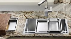 D'Scoop is all for a well accessorized sink   BLANCOCARRIER in stainless steel and bridge chopping board   Image via Blanco Germany